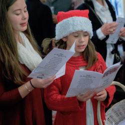 Holiday caroling at Highfield Hall